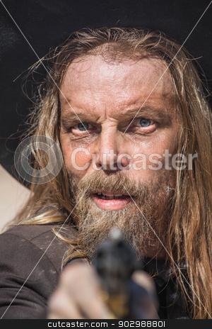 Cowboy Points Gun at You stock photo, Stern Cowboy Points a Gun at You by Scott Griessel