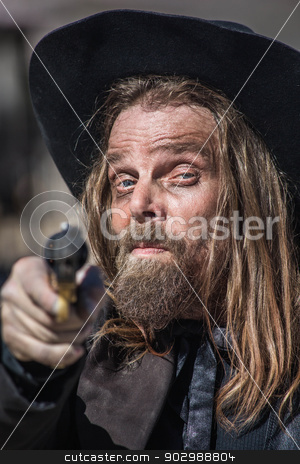 Cowboy Points Gun at You stock photo, Smiling Cowboy Points Gun at You by Scott Griessel