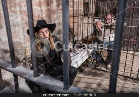 Two Imprisoned Men stock photo, Two Imprisoned Men Wait in Jail Cell by Scott Griessel