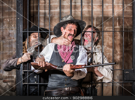 Prison Riot stock photo, Prisoners Revolt in an Old West Jail by Scott Griessel