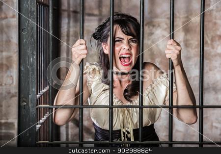 Portrait of Screaming Female Prisoner stock photo, Portrait of a Screaming Female Prisoner in the Oldwest by Scott Griessel