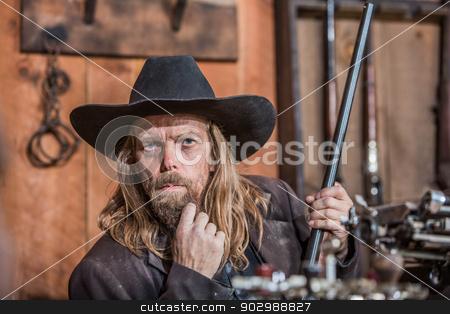 Portrait of a Cowboy stock photo, Portrait of a Stern Cowboy by Scott Griessel