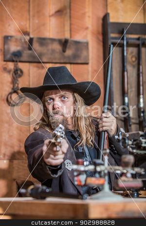 Sheriff Points Gun stock photo, Stern Sheriff Points Loaded Gun at You by Scott Griessel
