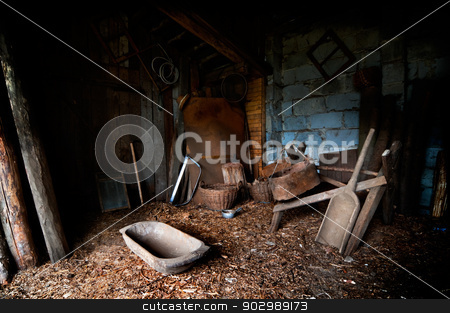 Old Barn stock photo, Old barn with a lot of tools and equipment by Tiramisu Studio