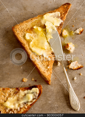 toasted butter stock photo, close up of toast bread with melted butter by zkruger