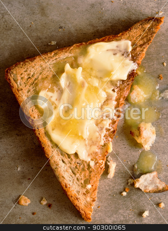 toasted bread stock photo, close up of a slice of toast with melted butter by zkruger