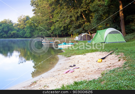 Tents at the Lake stock photo, A family campsite at the lake illuminated by early morning sunlight.  by Delmas Lehman