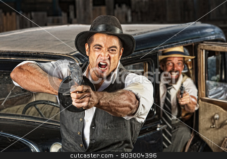 Angry Mobsters Shooting Gun stock photo, Angry mobsters firing submachine gun near antique car by Scott Griessel