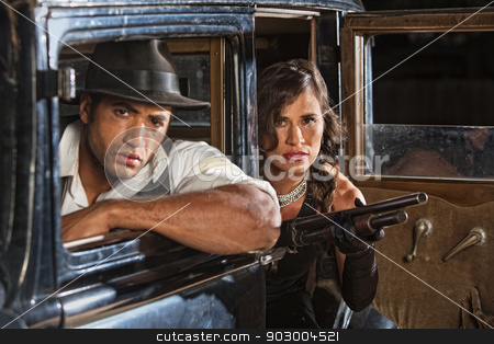 1920s Era Gangster Duo stock photo, 1920s gangster duo in car with shotgun on look out by Scott Griessel