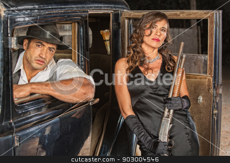 Gangsters with Shotgun in Car stock photo, Tough male and female gangsters with shotgun in car by Scott Griessel