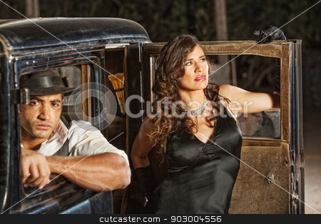 1920s Gangster Driver and Woman stock photo, Gangster driver in old car and beautiful woman by Scott Griessel