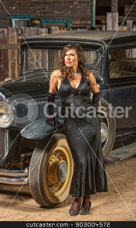 Retro Woman Near Old Car stock photo, Vintage automobile and beautiful woman in black dress by Scott Griessel
