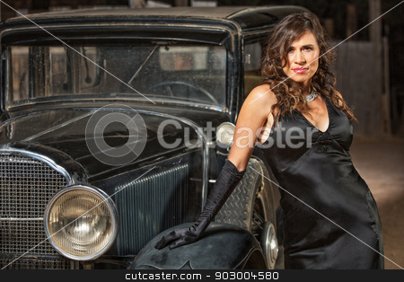Seductive Woman by Antique Car stock photo, Seductive woman in black leaning on antique automobile by Scott Griessel