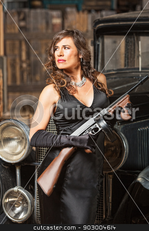 Confident Gangster Woman with Gun stock photo, Confident 1920s vintage gangster lady with machine gun by Scott Griessel