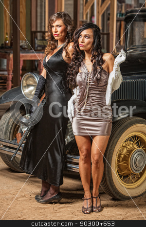 Beautiful Female 1920s Gangsters stock photo, Beautiful pair of female 1920s vintage gangsters outside by Scott Griessel