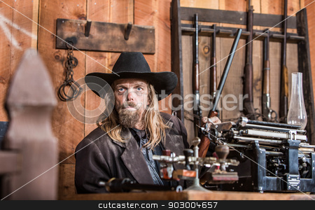 Portrait of a Cowboy stock photo, Portrait of a Stern Cowboy in Office by Scott Griessel