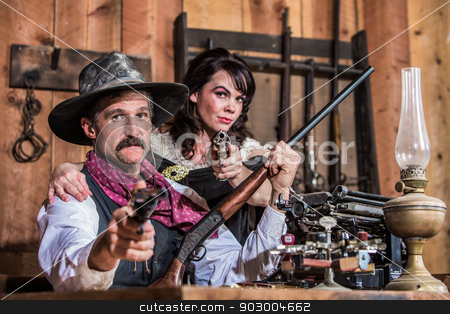 Sheriff Points Gun With Woman stock photo, Sheriff Stands With Woman and a Loaded Gun by Scott Griessel
