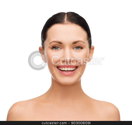 young laughing woman stock photo, health, spa and beauty concept - clean face of beautiful young laughing woman by Syda Productions