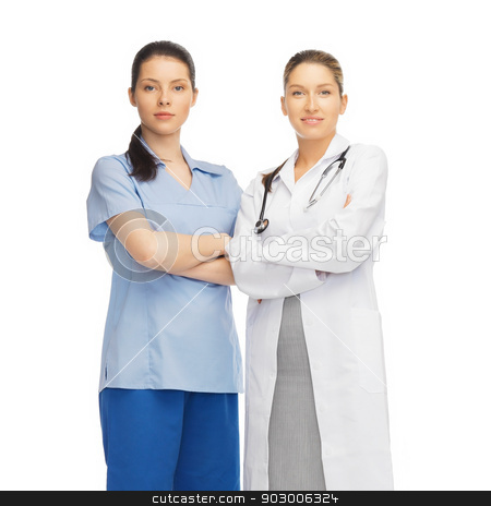 two doctors in uniform stock photo, healthcare and medical concept - two doctors in uniform by Syda Productions