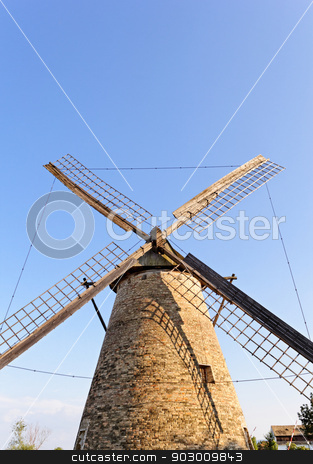 Old wooden mill against the blue sky stock photo, Old wooden windmill against the blue sky by Jozsef Demeter