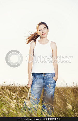 Woman on a summer day stock photo, Outdoor portrait of a beautiful woman on a summer day by ikostudio