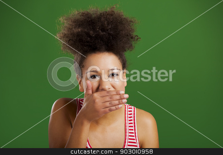 Laughing stock photo, Beautiful African woman laughing over a green background by ikostudio