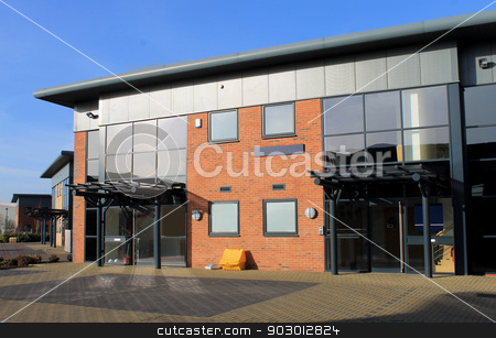 Modern office buildings stock photo, Exterior of empty modern commercial office buildings on business park, England. by Martin Crowdy