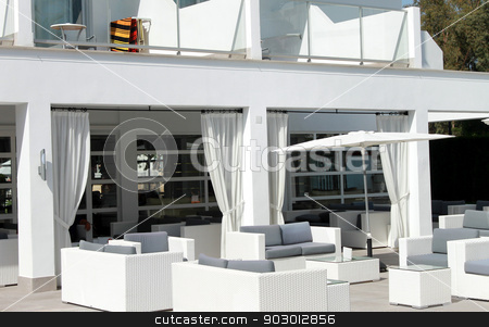Sofa on outdoor patio area stock photo, Luxurious patio area outside hotel with chairs and sofas. by Martin Crowdy