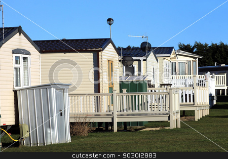 Trailers in caravan park stock photo, Row of static trailers in caravan park, Scarborough, England. by Martin Crowdy