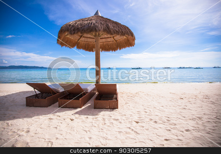 Beach wooden chairs for vacations and summer getaways in Boracay stock photo, Beach wooden chairs for vacations and summer getaways in Boracay by Dmitry Travnikov
