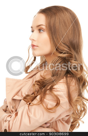 lovely woman in coat stock photo, bright picture of lovely woman in coat by Syda Productions
