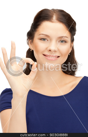 lovely teenage girl showing ok sign stock photo, bright picture of lovely teenage girl showing ok sign by Syda Productions