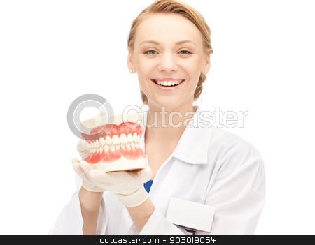 doctor with jaws stock photo, picture of attractive female doctor with jaws by Syda Productions