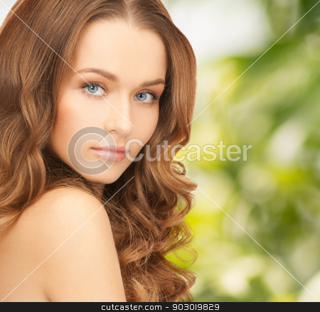 beautiful woman with long hair stock photo, health and beauty, eco, bio, nature concept - face of beautiful woman with long hair over green background by Syda Productions