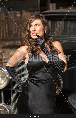 Pretty Woman in Black Looking Up stock photo, Pretty Hispanic female in black looking up by Scott Griessel