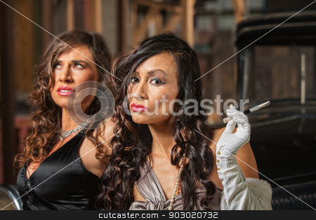 Two Beautiful Retro Women stock photo, Two beautiful Latino women in retro style dresses by Scott Griessel