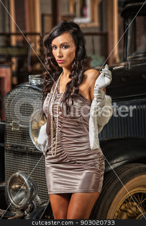 Smoking Woman in Mini Skirt stock photo, Serious 1920s era woman in mini skirt with cigarette by Scott Griessel