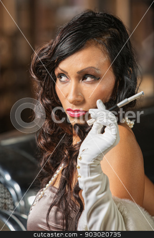 Smoking Woman Looking Over stock photo, Stylish gorgeous female with cigarette looking over by Scott Griessel