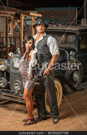 Tough Gangster with Cute Woman stock photo, Handsome muscular 1920s gangster with lady in mini skirt by Scott Griessel