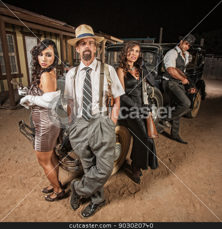 Criminal Gangster Group stock photo, Gangster with hands in pockets next to partners in crime by Scott Griessel