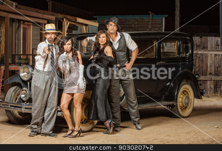 Gangsters Aiming Guns stock photo, Group of 1920s vintage gangsters outside aiming weapons by Scott Griessel