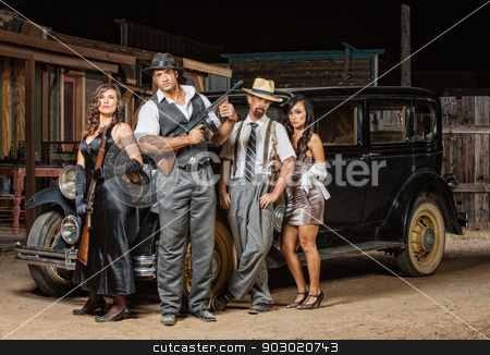 Four Gangsters Posing stock photo, Group of male and female gangsters with guns by Scott Griessel