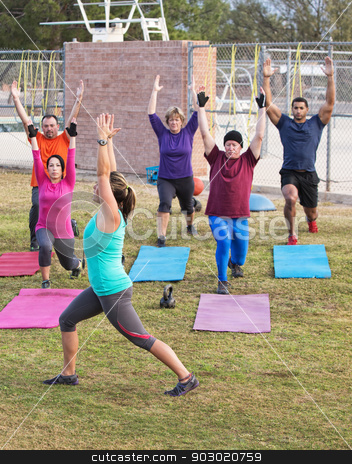 Exercise Class Stretching Outdoors stock photo, Mature adult boot camp exercise group stretching outdoors by Scott Griessel