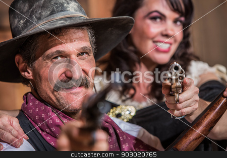 Cowboy and Saloon Girl Point Weapons stock photo, A Smiling Cowboy and Saloon Girl Point Their Weapons at You by Scott Griessel