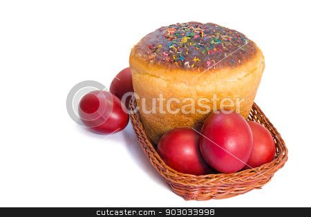 Red Easter eggs and Easter bread in a basket on a white backgrou stock photo, Easter eggs are dyed red , and Easter bread in a wicker basket. Presented on a white background. by Georgina198