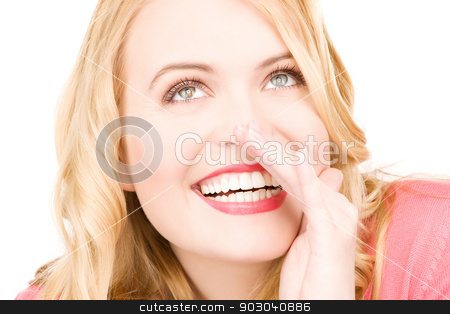 gossip stock photo, bright picture of young woman whispering gossip by Syda Productions