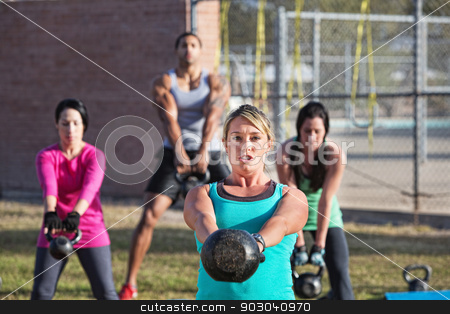 Fit Men and Women Exercising Outdoors stock photo, Fit woman leading group of adults with weights by Scott Griessel