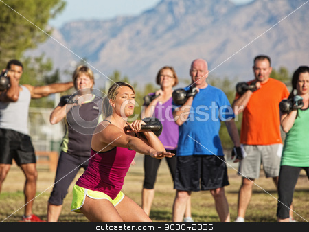 Mixed Group of People Exercising stock photo, Mixed group of people working out near mountains by Scott Griessel
