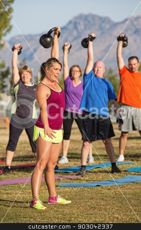 Boot Camp Exercise Class Lifting Weights stock photo, Boot camp exercise class lifting kettle bell weights by Scott Griessel