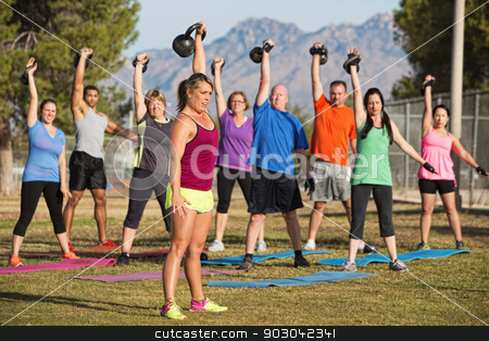 Mixed Group Lifting Kettle Bells stock photo, Mixed group of men and women lifting weights outdoors by Scott Griessel